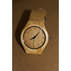 Round-faced engraved wooden watch